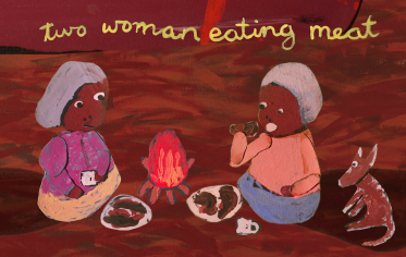 Two Woman eating meat